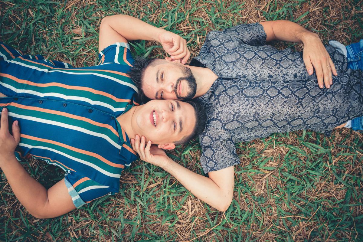 image-two-men-lying-on-green-grass-2440069.jpg